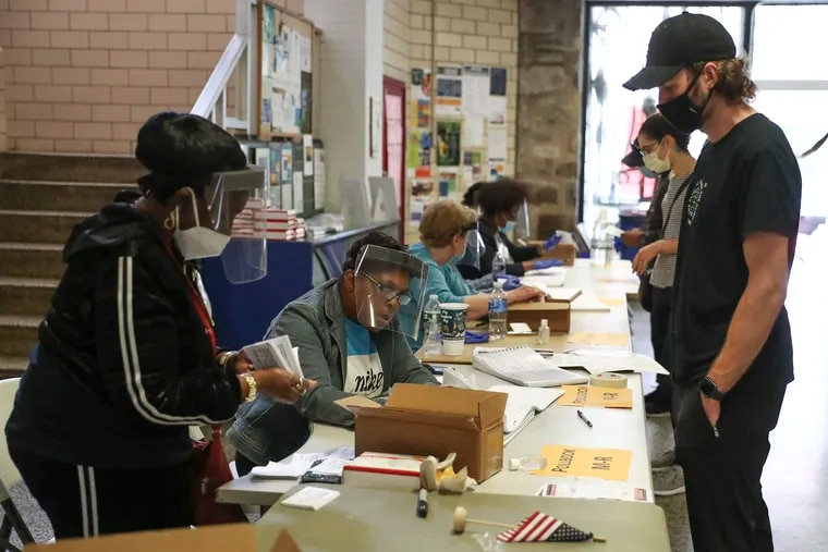 Voters sign in at the Marian Anderson Recreation Center in Philadelphia on Tuesday.