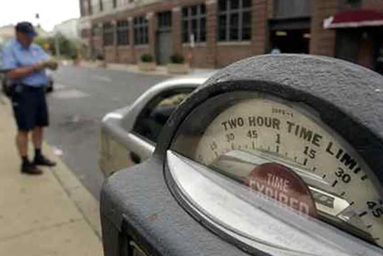 The unforgiving efficiency of the Phila. Parking Authority is the subject of a TV series - and a turnoff to potential visitors. (David Swanson / Staff Photographer)
