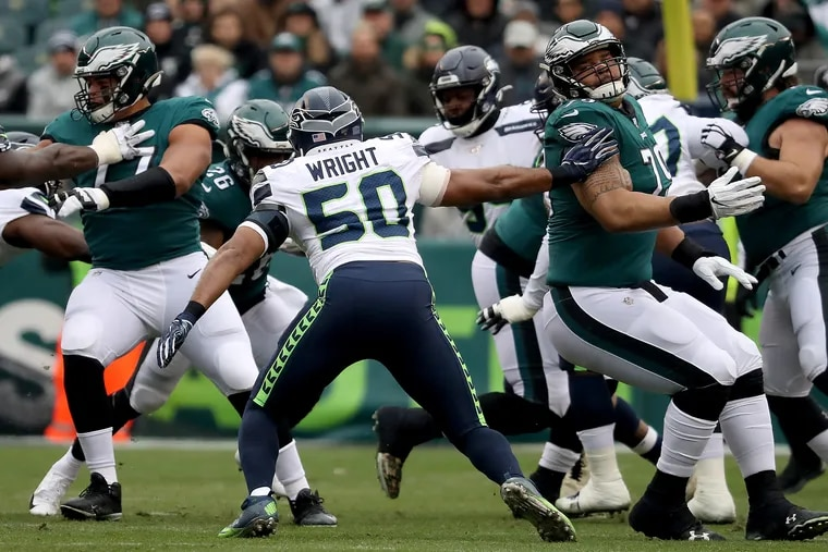 Eagles offensive guard Brandon Brooks (right) tries to block Seattle Seahawks outside linebacker K.J. Wright on Sunday during the Eagles' 17-9 loss.