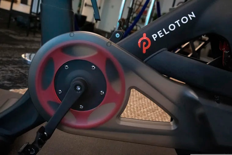 The Peloton logo is displayed on the company's stationary bicycle, Thursday, Sept. 26, 2019 in New York. (AP Photo/Mark Lennihan)