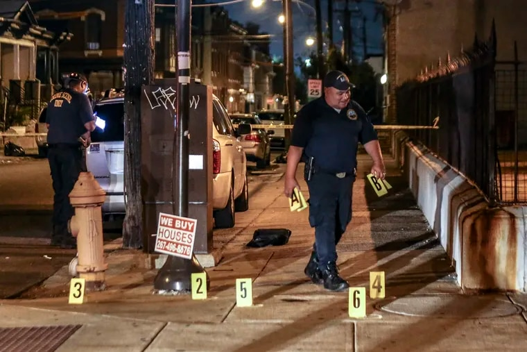 Crime scene police officers investigate a shooting at 11th Street and Lehigh Avenue where two 15-year-old males were shot, Monday, Sept. 13, 2021.