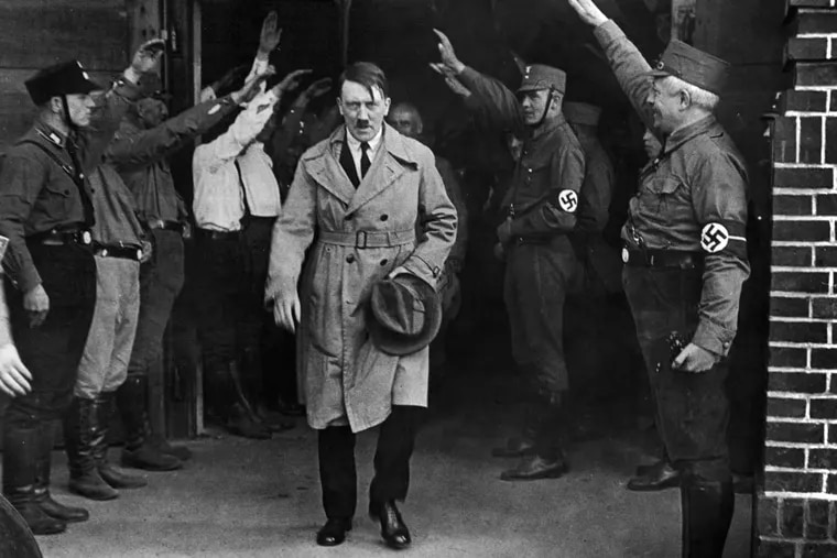 In this Dec. 5, 1931 file photo Adolf Hitler, leader of the National Socialists, leaves the party's Munich, Germany headquarters.
