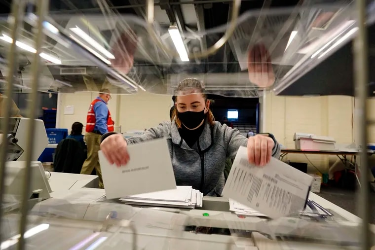 Chester County, Pa., election worker Kristina Sladek opens mail-in and absentee ballots for the 2020 General Election in the United States at West Chester University Tuesday in West Chester, Pa.