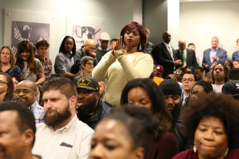 An audience member speaks about racism, discrimination and the LGBT community at a public hearing Tuesday held by the Philadelphia Commission on Human Relations.