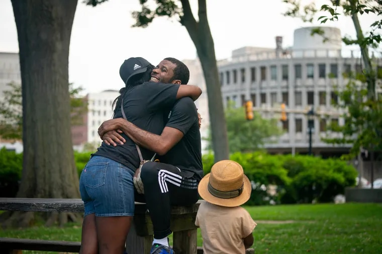 Tremell Foster with his fiancee Erica Jones and son Lennox at Franklin Square, near the Philadelphia Police Administration Building, two days after Foster was released from prison in Philadelphia earlier this month.