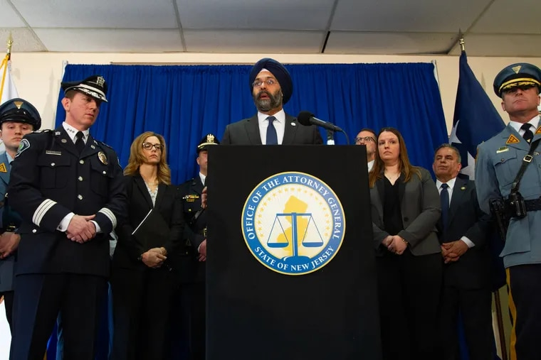 FILE - New Jersey Attorney General, Gurbir Singh Grewal, speaks next to members of the investigation team and state and county police officers during a press conference at Camden County Police Headquarters, on Federal St. in Camden, NJ Monday, March 18, 2019.