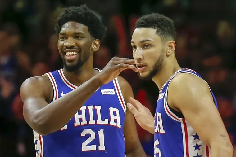 Sixers center Joel Embiid with teammate Sixers guard Ben Simmons after Embiid drew a technique foul on the Utah Jazz during the fourth-quarter on Monday, November 20, 2017 in Philadelphia.