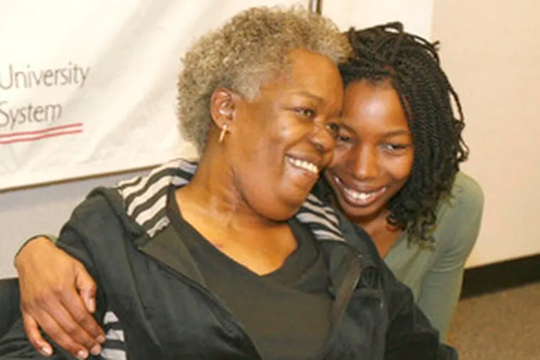 Hypertension patient Hazelene Jackson with her daughter, Marie. Jackson is the first person in the region to receive the device.