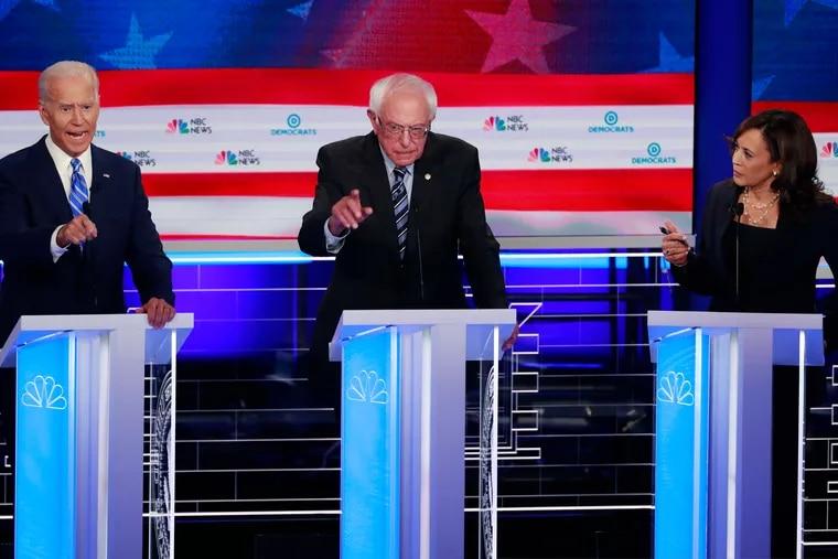 Former vice president Joe Biden (left), Sen. Bernie Sanders (I., Vt., center), and Sen. Kamala Harris speak simultaneously during a Democratic primary debate last month.