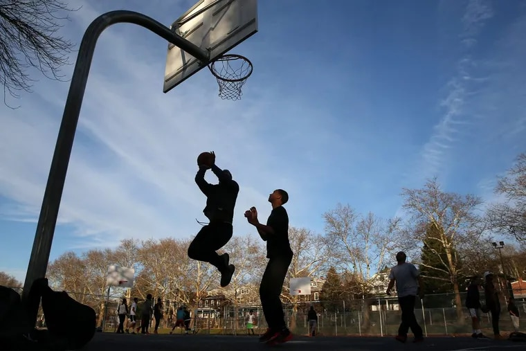 From left, Erick Ortiz, Christian Lozada and Winiel Cruz play basketball at the 11th and Pike Playground in Reading on Tuesday, Nov. 21, 2017. Former Reading Senior High School basketball star Lonnie Walker returns home Wednesday when his team, Miami, takes on La Salle at Santander Arena.