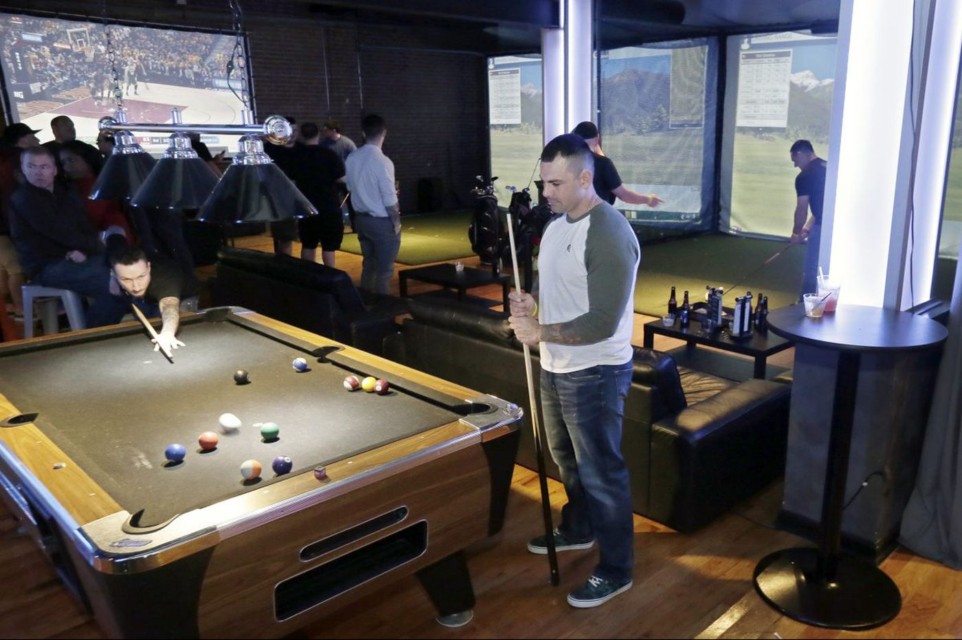 I tried Philly's weird new golf-simulator bar, Golf & Social