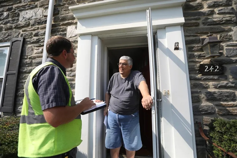 Dean Pappas of Lansdowne speaks with Russell Place, a data collector for Tyler Technologies, the company contracted by Delaware County to reassess every property in the county. The company is reviewing properties and making site visits to give every property a new value that will take effect in 2021.
