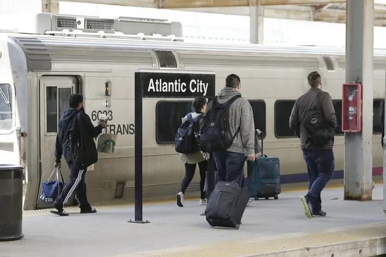 At the Atlantic City Rail Terminal, passengers get on a Atlantic City to Phila. train on April 29, 2018. ELIZABETH ROBERTSON / Staff Photographer