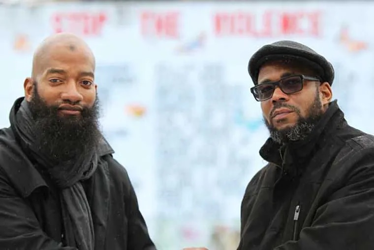 Will Little, left, and Lamont Hatton, right, get together at 20th and Tasker streets in Philadelphia, Pa. on February 5, 2014. Little fatally shot Hatton's brother in the 1980s. After wanting to revenge-kill Little for years, Hatton suddenly forgave him so they both could live in peace. ( DAVID MAIALETTI / Staff Photographer )