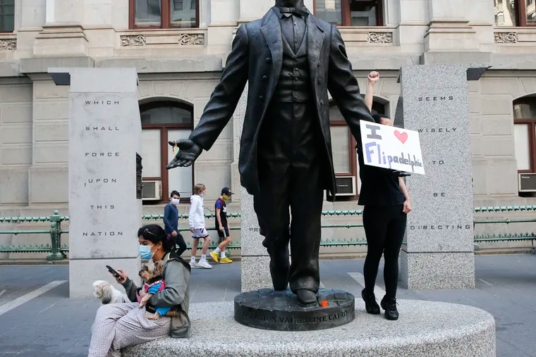 """A statue of Octavius V. Catto outside City Hall in November. The heirs to Catto's efforts on voting rights """"must remain vigilant and tireless in the face of constant attempts to undercut the hard-won victories of the past,"""" writes the Rev. Mark Kelly Tyler."""