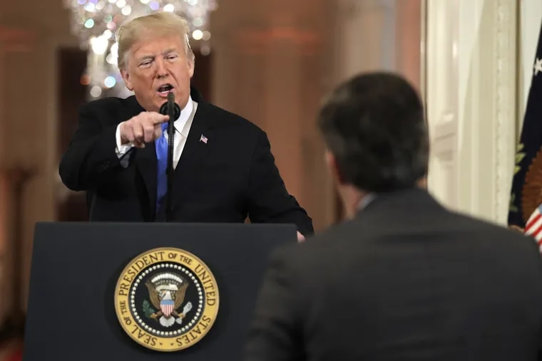 President Donald Trump points as he speaks during a news conference in the East Room of the White House, Wednesday, Nov. 7, 2018, in Washington.