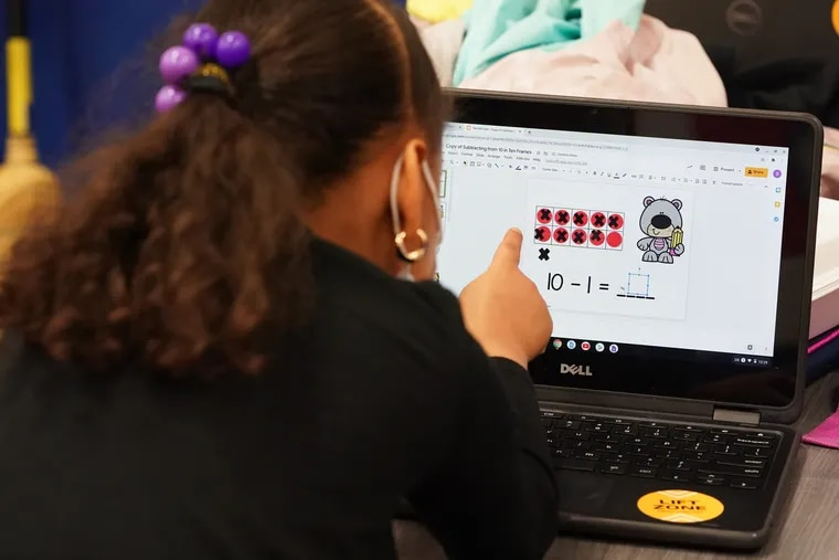 """Saniah Keel, 6, works on a math learning game on a computer at the Victorino Boys & Girls Club in Philadelphia, April 22, 2021. The Victorino Boys & Girls Club is one of Comcast's """"Lift Zones,"""" community centers that offer free WiFi to low-income residents who cannot afford or access the internet at home."""