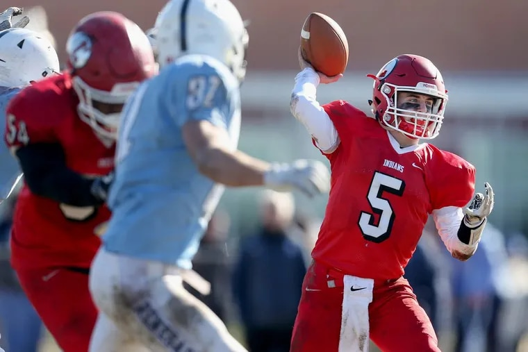 Lenape's Matt Lajoie (5) throws a pass during the annual Thanksgiving day game against Shawnee.