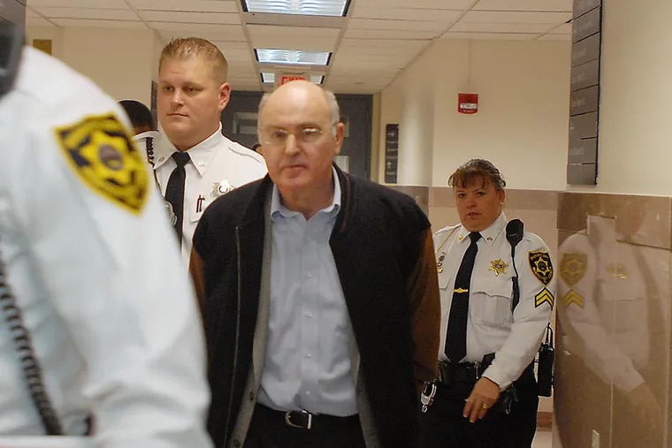 Ex-Penn professor Rafael Robb is led to his sentencing hearing in the Montgomery County Courtroom on November 19, 2008. (Ron Tarver / Staff Photographer)