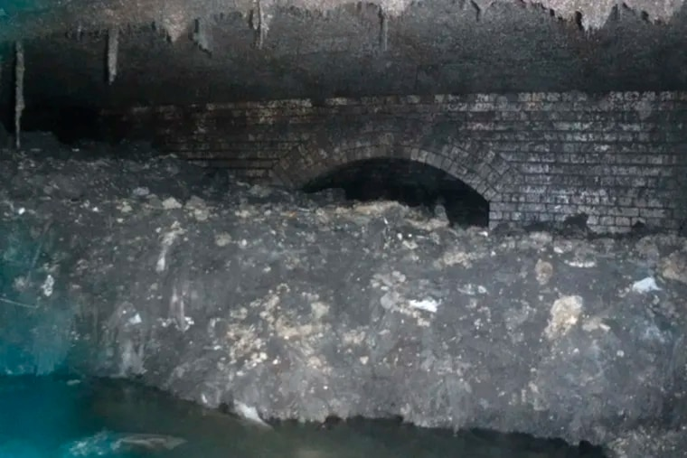 """In this photo released Tuesday Jan. 8, 2019, by Britain's South West Water company, showing part of a """"fatberg"""", a mass of hardened fat, oil and baby wipes, measuring some 64 meters (210 feet) long, in the town of Sidmouth, England.  The fatberg is blocking a sewer in the southwestern English town, and will take a sewer team around eight weeks to dissect and dispose of the obstruction."""