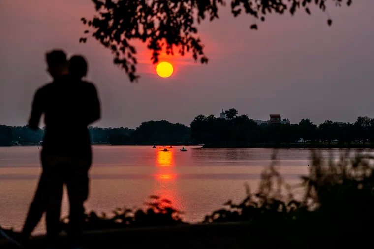 West Coast wildfire smoke makes for a vivid sunset in our region on Tuesday, setting over the Cooper River in Camden County.