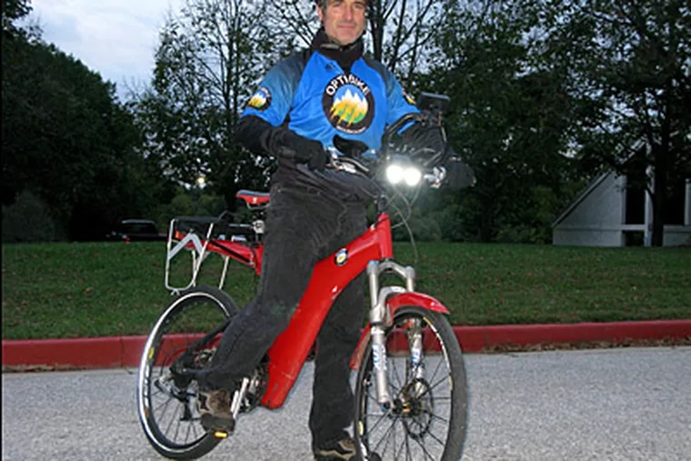 Dan Rowell commutes to his job in Sykesville, Maryland, on a battery assisted Optibike. Rowell has been using the hybrid bicycle for the past two years for his 22-mile commute from his home in Laurel. (Jerry Jackson/Baltimore Sun/MCT)