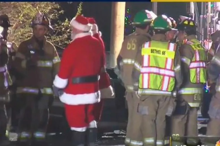 Rescue workers, including two dressed as Santa, responded to a car collision that seriously injured four nuns and a young Delaware County driver.