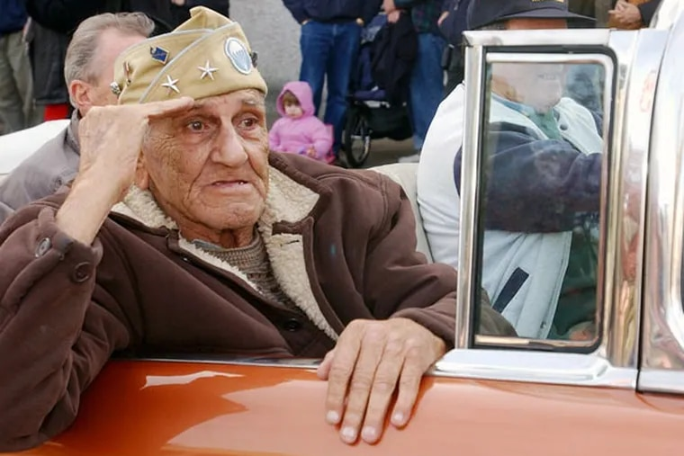 Bill Guarnere salutes the crowd during the 2004 Veterans Day Parade in Media.