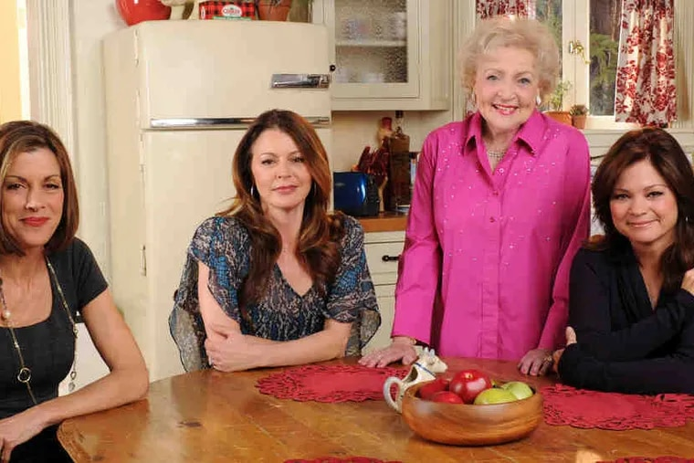 """Betty White (standing) with her """"Hot in Cleveland"""" costars (from left) Wendie Malick, Jane Leeves, and Valerie Bertinelli. Her advice: """"Don't try to be young. . . . Stay interested in stuff."""""""