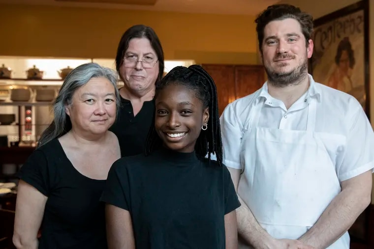Owners Cathy Lee (left) and Francis Cretarola (back) with Christine Thompson (front) and chef Damon Menapace at Le Virtu restaurant in South Philadelphia.