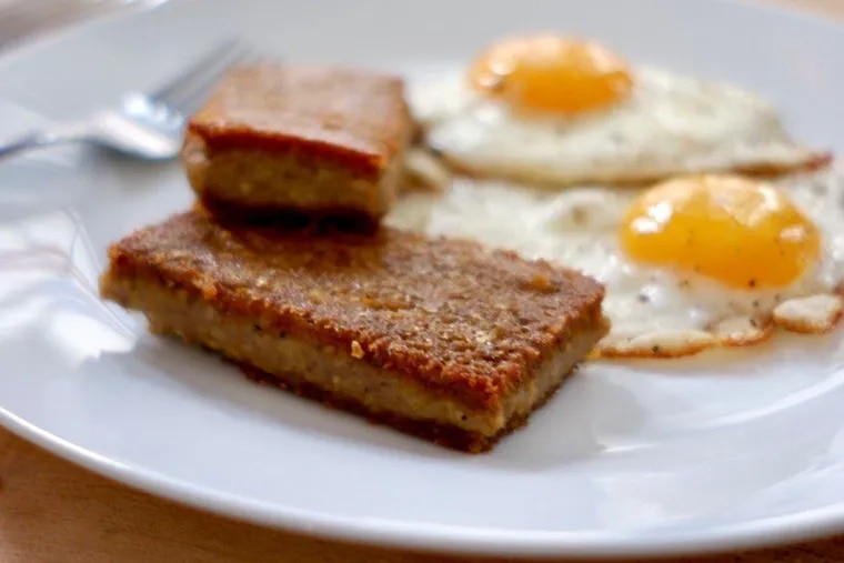 Two slices of fresh scrapple made from local ingredients by Primal Supply Meats.