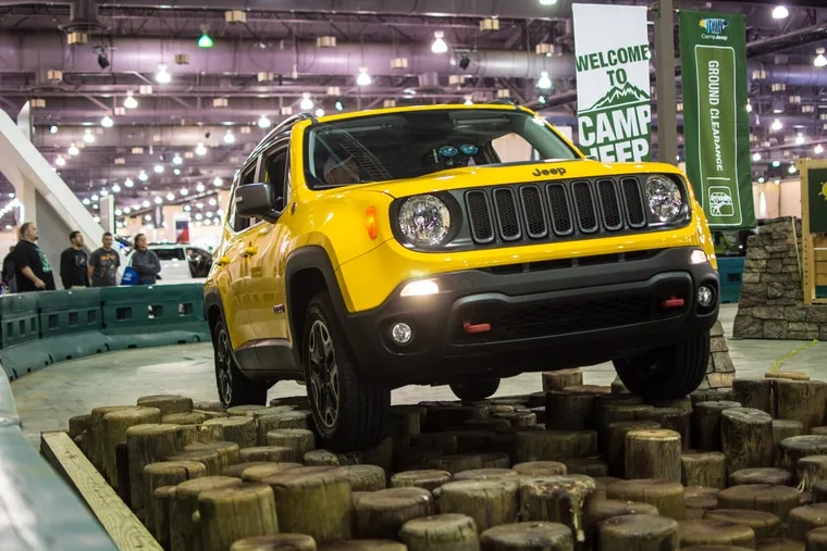 Representatives for Camp Jeep show off their latest models by inviting attendants to participate in a short obstacle course at the 2016 Philadelphia Auto Show.