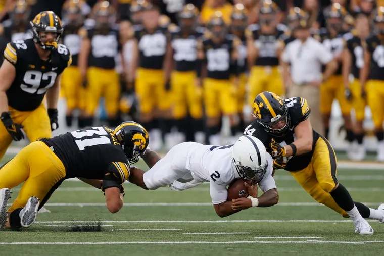 Penn State quarterback Ta'Quan Roberson dives for more yards as Iowa linebackers Jack Campbell (31) and Seth Benson (44) make the tackle during the second half Saturday.