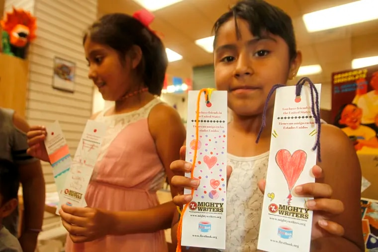 Dana, age 10, shows off some of the bookmark designs she crafted for the kids being detained at the Berks County detention center. Mighty Writers, a nonprofit that teaches youth writing skills, is sending 100 Spanish-language children's books, each paired with a bookmark, to the facility next week.