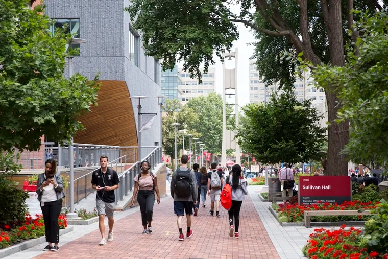 Students walk across the Temple University campus on the first day of the fall semester.