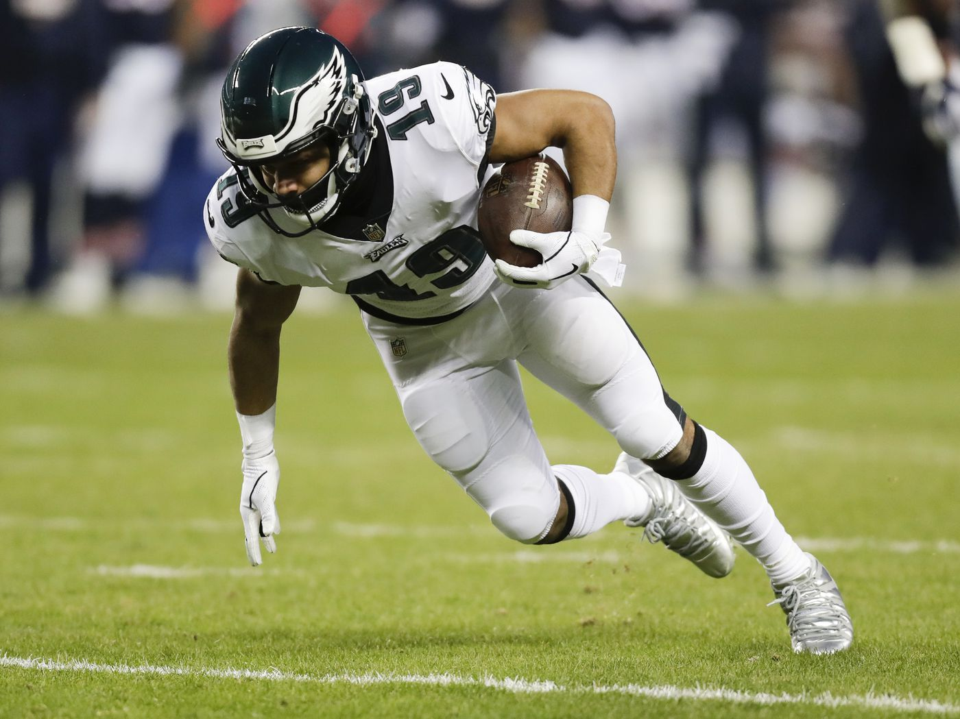 30b8dccdb Eagles wide receiver Golden Tate runs with the football against the Chicago  Bears in a NFC