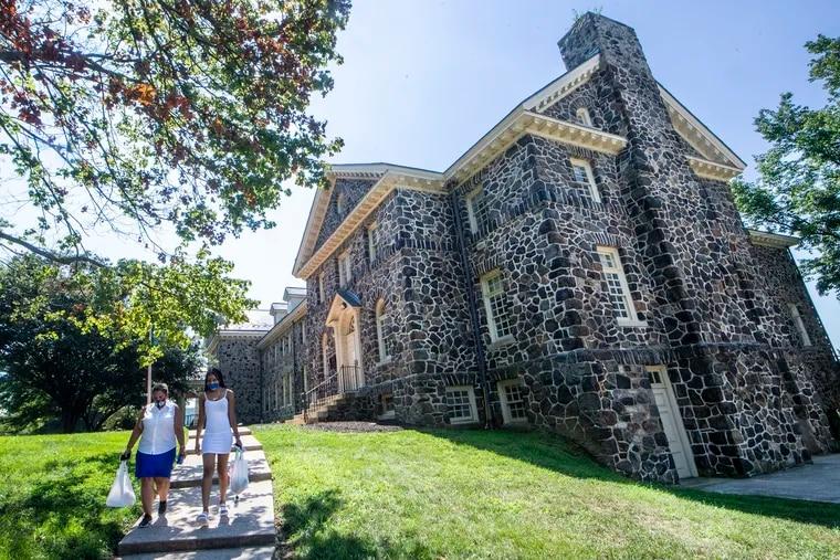 Students walk around campus at Cheyney University.