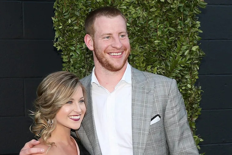Carson Wentz and his fiancée, Madison Oberg, pose for photos while entering the Eagles' Super Bowl championship ring ceremony at 2300 Arena in South Philadelphia on Thursday, June 14, 2018.