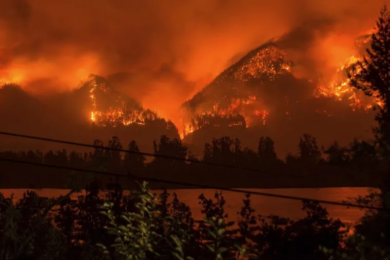 FILE – Photo provided by KATU-TV shows a wildfire near Stevenson Wash. in September. A new government report on climate change says to expect more such fires.