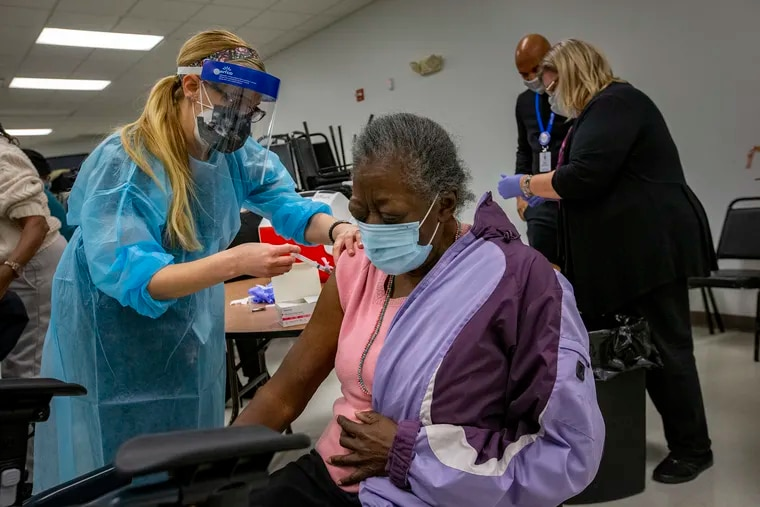 Dr. Stephanie Santoro, MD gives Helen Clay, 75, her COVID-19 vaccination in Camden on Thursday.