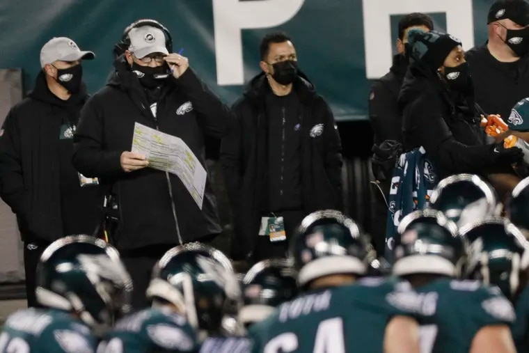 Eagles head coach Doug Pederson (second from left) looked on from the sidelines with fogged glasses during the Eagles' 20-14 loss to the Washington Football Team on Jan. 3.