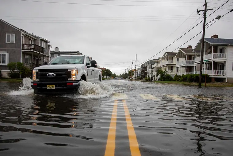 A truck drives through the flooded streets at 4th Street and Simpson Avenue in Ocean City due to Tropical Storm Faye last July.