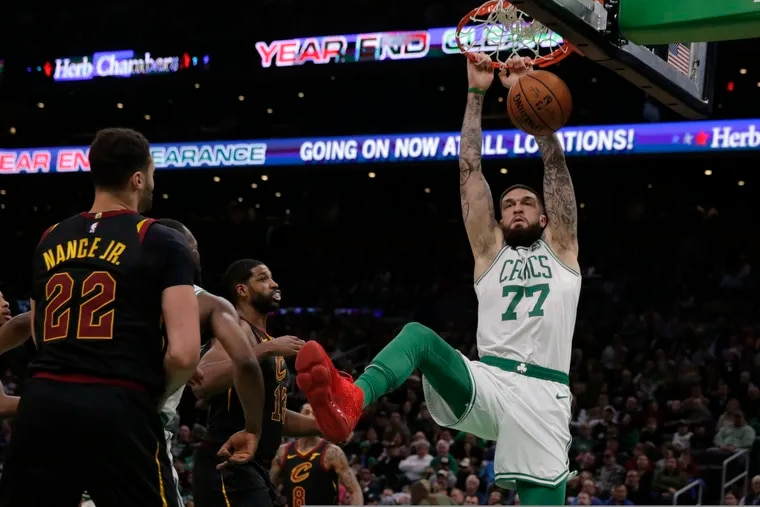 Center Vincent Poirier (77) slams a dunk during the second half of an NBA basketball game against the Cleveland Cavaliers on Dec. 9, 2019. The Celtics won 110-88.