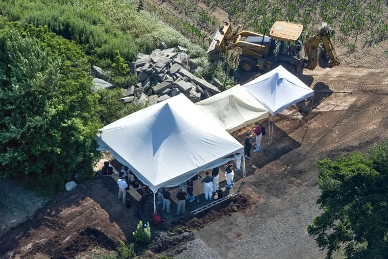 Investigators are back at the DiNardo family farm off Lower York Road in Solebury digging with a backhoe July 12, 2017 trying to find clues to the disappearance of four Bucks County men.