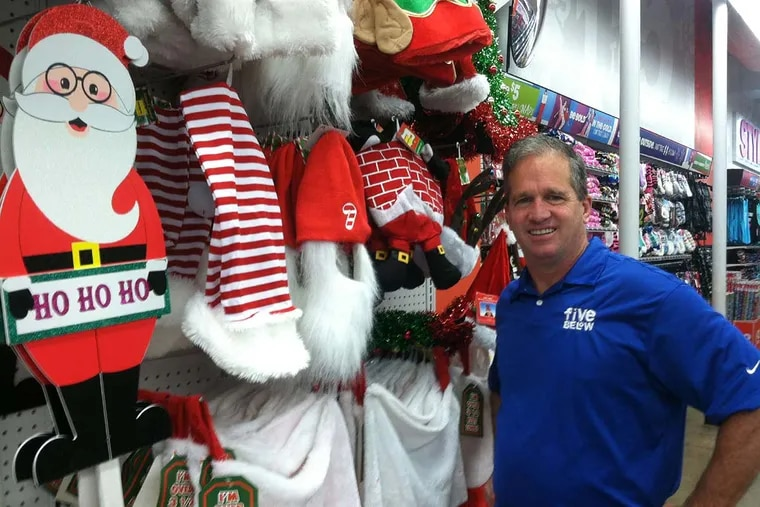 Joel D. Anderson , at a Five Below outlet on the 1500 block of Chestnut Street, looks for pride in the stores.