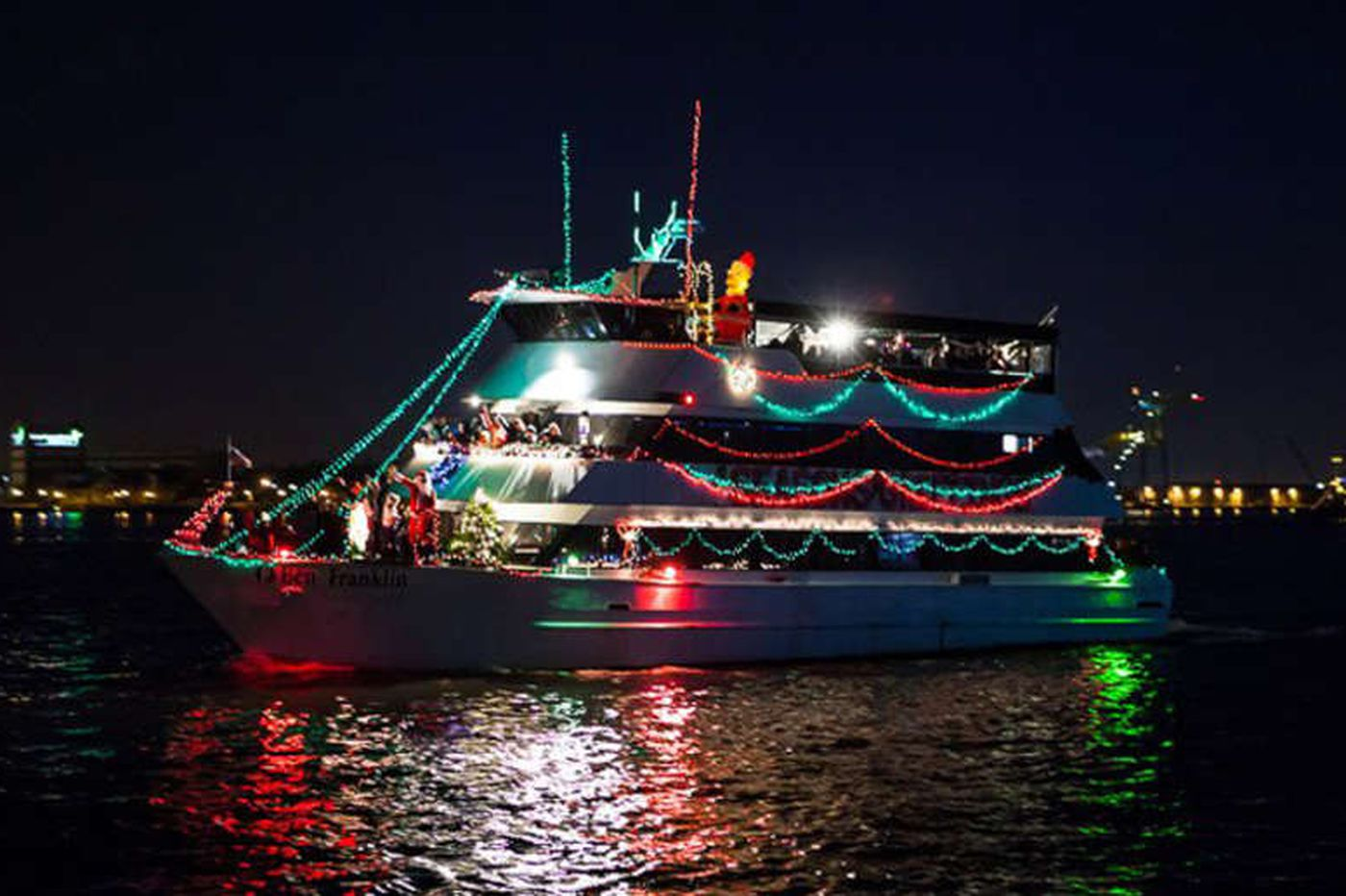 At Seaport Museum Christmas is bright with boats in lights
