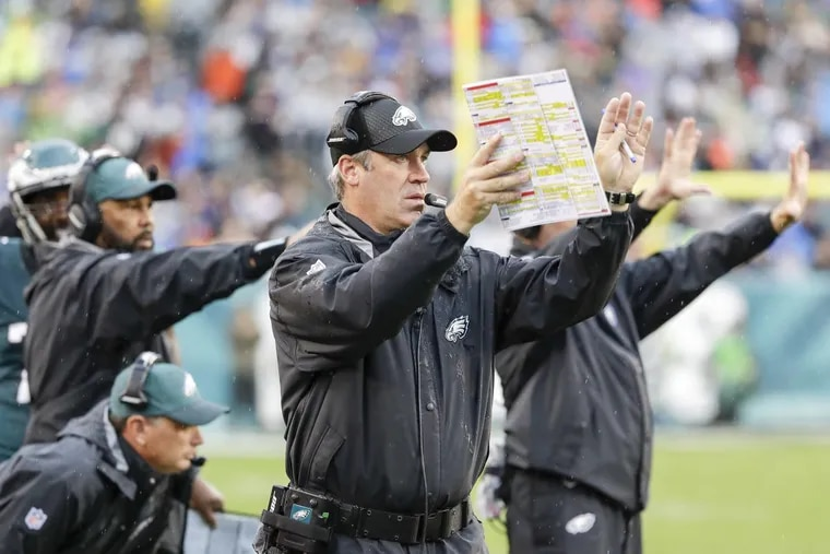 Head Coach Doug Pederson waving to his team against the San Fransisco 49ers on Sunday, October 29, 2017 in Philadelphia. YONG KIM / Staff Photographer
