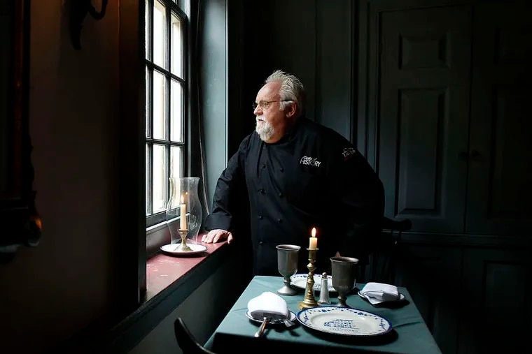 Chef Walter Staib looking out a window at City Tavern in 2013.
