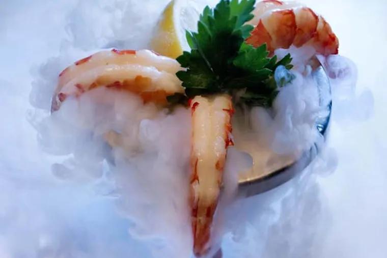Smoking shellfish tower with shrimp as served at Ocean Prime, 124 South 15th St., Philadelphia, December 5, 2012.  ( DAVID M WARREN / Staff Photographer )