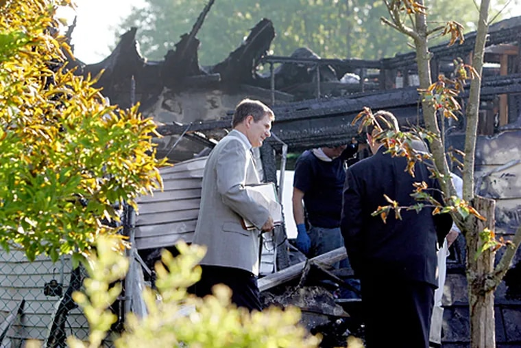 Officials are investigating the cause of explosions and a fire that killed three people in a house in Pemberton Township early Monday morning.